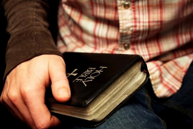 man_holding_bible-a4